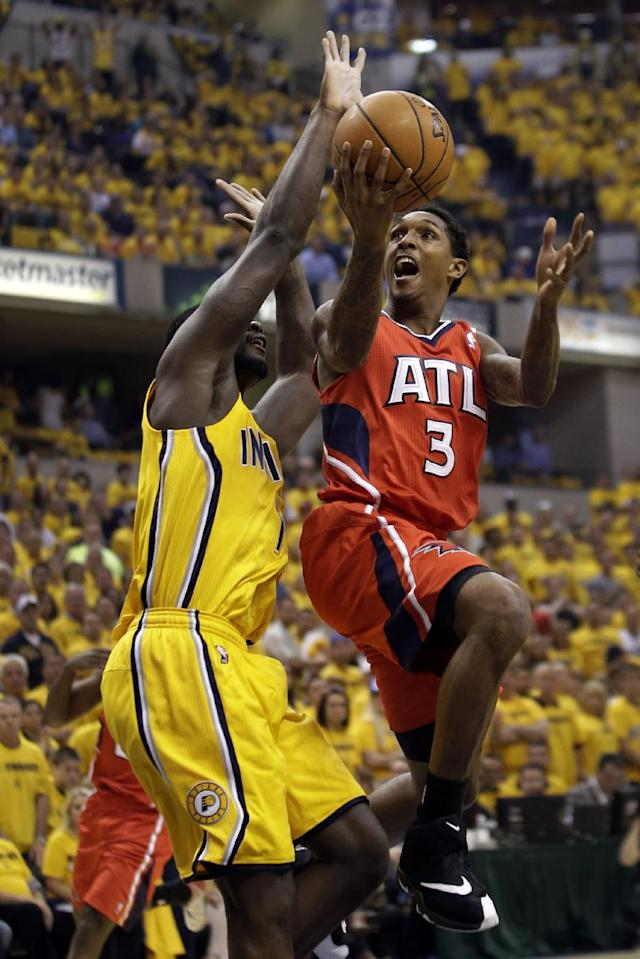 Atlanta Hawks guard Louis Williams, right, shoots around the defense of Indiana Pacers guard Lance Stephenson during Game 7 of a first-round NBA basketball playoff series in Indianapolis, Saturday, May 3, 2014. (AP Photo/AJ Mast)