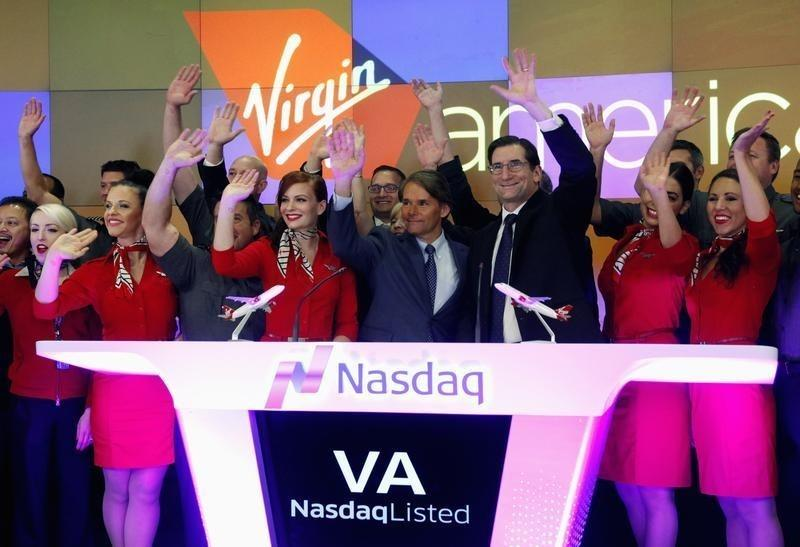 Virgin America Inc. President and Chief Executive Officer Cush waves after ringing the opening bell of the trading session as Virgin America Inc. celebrated its initial public offering at the NASDAQ Market Site in New York