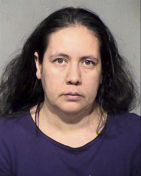 This April 2019 mugshot provided by the Maricopa County Sheriff's Office in Phoenix shows Brenda Acuna-Aguero. Acuna-Aguero and her husband are accused of forcing a day laborer to have sex with her at gunpoint and filming the encounter to extort him. (Maricopa County Sheriff's Office via AP)