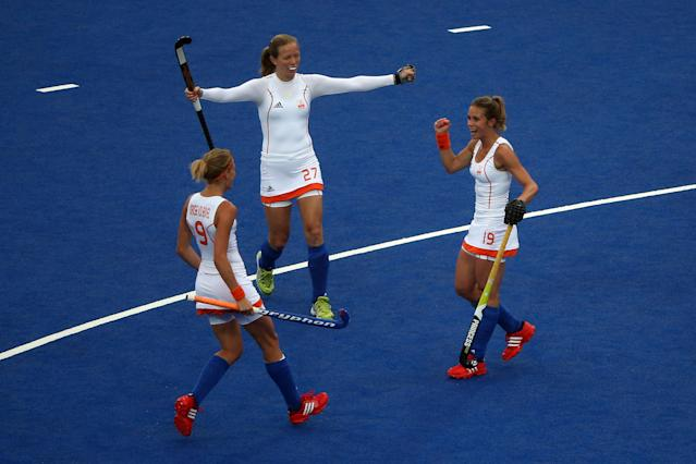 LONDON, ENGLAND - JULY 31: Ellen Hoog (R) of the Netherlands is congratulated by team-mates Carlien Dirkse van den Heuvel (L) and Marilyn Agliotti after scoring their second goal during the Women's Hockey Match between the Netherlands and Japan on day 4 of the London 2012 Olympic Games at Hockey Centre on July 31, 2012 in London, England. (Photo by Daniel Berehulak/Getty Images)