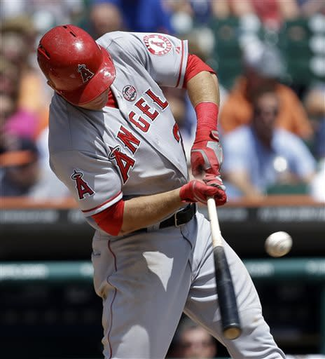 Los Angeles Angels' Mike Trout hits a double against the Detroit Tigers in the third inning of a baseball game in Detroit, Thursday, June 27, 2013. The (AP Photo/Paul Sancya)