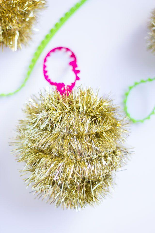 """<p>You'd be surprised how many glittering ornaments you can make with a single roll of tinsel from the dollar store. </p><p><em>Get the tutorial at <a href=""""https://designimprovised.com/2015/12/diy-tinsel-garland-ornaments.html"""" rel=""""nofollow noopener"""" target=""""_blank"""" data-ylk=""""slk:Design Improvised"""" class=""""link rapid-noclick-resp"""">Design Improvised</a>.</em></p><p><a class=""""link rapid-noclick-resp"""" href=""""https://www.amazon.com/DECORA-Christmas-Decorations-Birthday-Supplies/dp/B07F17PKQD/?tag=syn-yahoo-20&ascsubtag=%5Bartid%7C10072.g.34443405%5Bsrc%7Cyahoo-us"""" rel=""""nofollow noopener"""" target=""""_blank"""" data-ylk=""""slk:SHOP TINSEL"""">SHOP TINSEL</a></p>"""