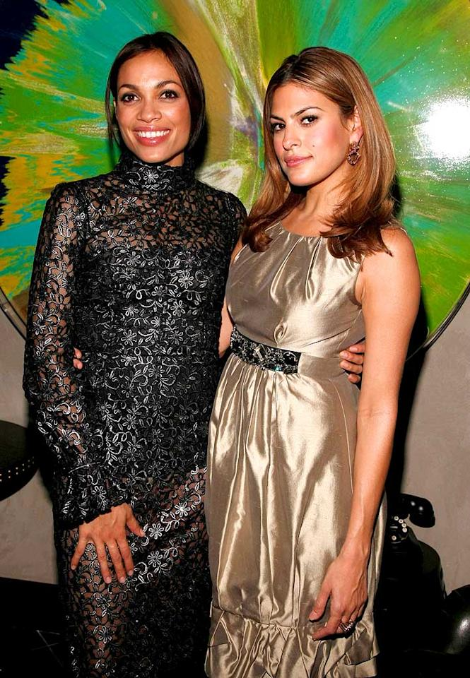 "Rosario Dawson (""Sin City,"" ""Rent,"" ""Clerks II"") and Eva pose for a picture. Which Hollywood hottie do you think looks better? We definitely aren't feeling Ms. Dawson's matronly, curtain-inspired gown. Jemal Countess/<a href=""http://www.wireimage.com"" target=""new"">WireImage.com</a> - December 4, 2007"