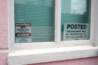 """Warning signs are posted in this set of windows in the front of the Jackson Women's Health Organization clinic, also known as """"The Pink House,"""" Wednesday, May 19, 2021, in Jackson, Miss. The Supreme Court agreed to take up a dispute over a Mississippi ban on abortions after 15 weeks of pregnancy, with their decision affecting whether the state's only medical facility will continue to be able to provide abortions on demand. (AP Photo/Rogelio V. Solis)"""