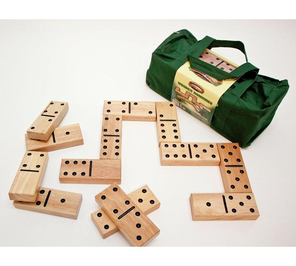 """<p>Challenge your family and friends to a giant game of numerical skill.<br></p><p> <strong>Wooden Dominoes by Traditional Garden Games, £64.99, Argos</strong></p><p><a href=""""http://www.argos.co.uk/product/4115379"""" rel=""""nofollow noopener"""" target=""""_blank"""" data-ylk=""""slk:BUY NOW"""" class=""""link rapid-noclick-resp"""">BUY NOW</a></p>"""