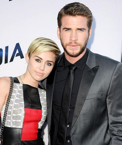 "Miley Cyrus, Liam Hemsworth Acted Like ""Strangers"" at Paranoia Premiere"