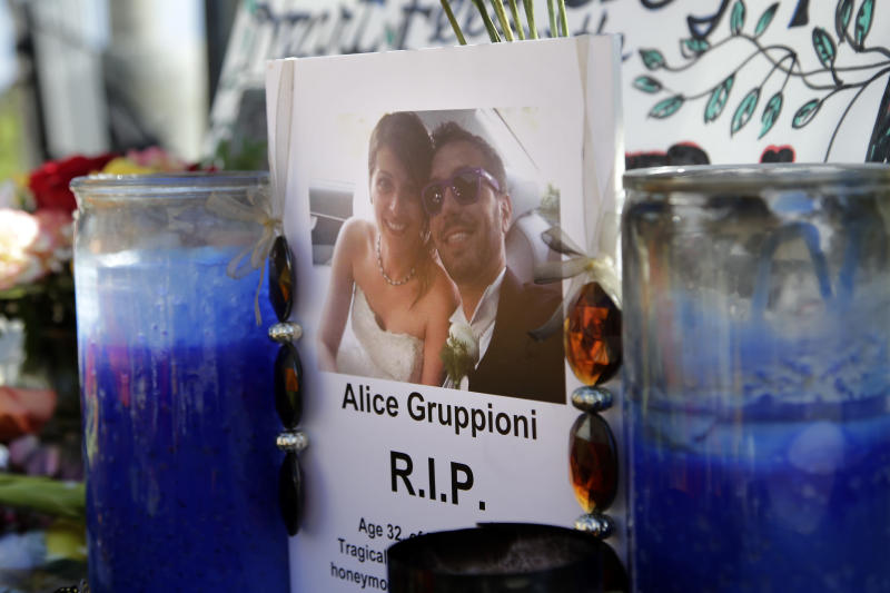 A card showing the photo of Italian newlywed Alice Gruppioni, left, and her husband Christian Casadei, is placed on a makeshift memorial for Gruppioni along Ocean Front Walk at Venice Beach on Monday, Aug. 5, 2013, in Los Angeles. The man suspected of being behind the wheel of a sedan that careened down the crowded Venice Beach boardwalk last weekend, killing the Italian newlywed on her honeymoon and injuring 16, is a transient who served brief stints in jail in Colorado, authorities said Monday. (AP Photo/Jae C. Hong)
