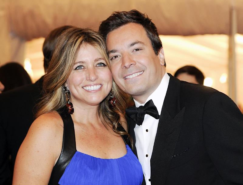 "FILE - This May 7, 2012 file photo shows Jimmy Fallon and his wife Nancy Juvonen, left, at the Metropolitan Museum of Art Costume Institute gala benefit, celebrating Elsa Schiaparelli and Miuccia Prada in New York. Fallon says he and his wife had their baby daughter with the help of a surrogate. Winnie Rose Fallon, the daughter of the NBC late-night comic and his wife Nancy Juvonen, was born July 23. Fallon said in a portion of a ""Today"" show interview broadcast Friday that the couple had been trying for awhile to have a child before succeeding with the help of a surrogate. (AP Photo/Evan Agostini, File)"