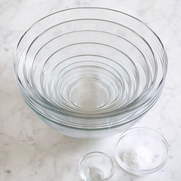 """If you trust yourself (and your family) with glass, Williams Sonoma's 10-piece mixing bowl set is generous in quantity and a top-performer, too. (The bowls are made of durable tempered glass.) Thompson, who says this set is also a favorite, tells <em>Glamour:</em> """"This basic set is affordable and allows you to cover all your bases in terms of prep, storage, and serving."""" They stand up to extreme temperatures and are also microwave-safe, so, for instance, if you need to melt baking chocolate, one of these bowls is up to the task. They're also fine to put in the dishwasher and easy to store. $40, Williams Sonoma. <a href=""""https://www.williams-sonoma.com/products/glass-mixing-bowl-10-piece-set/"""" rel=""""nofollow noopener"""" target=""""_blank"""" data-ylk=""""slk:Get it now!"""" class=""""link rapid-noclick-resp"""">Get it now!</a>"""