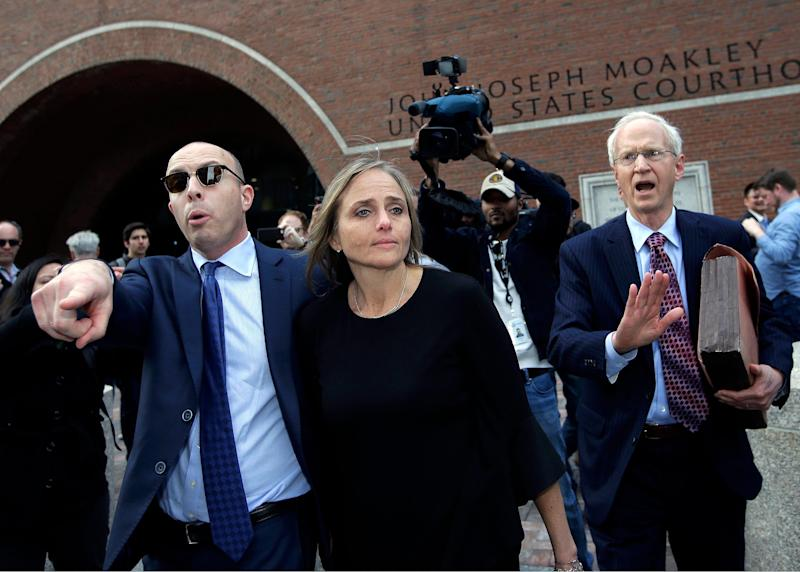 District Court Judge Shelley M. Richmond Joseph, center, departs federal court on April 25, 2019, in Boston after facing obstruction of justice charges for allegedly helping a man in the country illegally evade immigration officials.