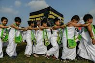Malaysian children parade in white robes for practice hajj