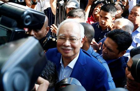 Malaysia's former prime minister Najib Razak arrives to give a statement to the Malaysian Anti-Corruption Commission (MACC) in Putrajaya, Malaysia.   REUTERS/Lai Seng Sin
