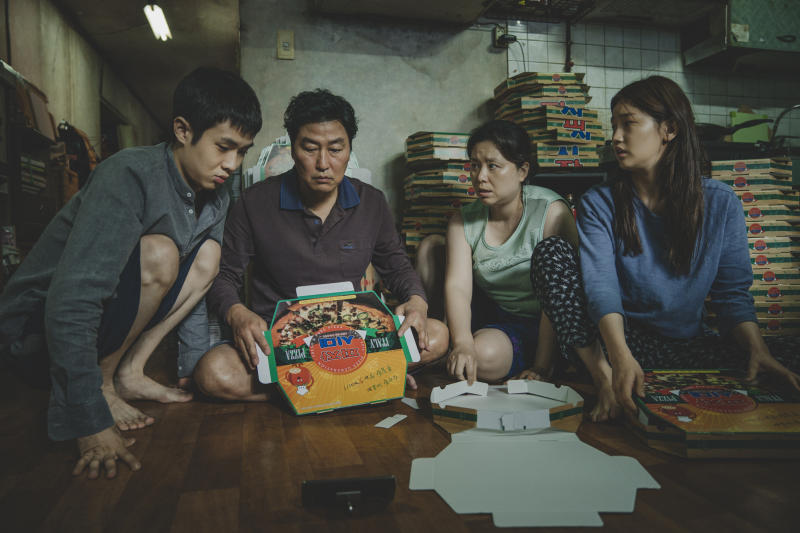 "This image released by Neon shows Woo-sik Choi, from left, Kang-ho Song, Hye-jin Jang and So-dam Park in a scene from ""Parasite."" On Monday, Dec. 9, 2019, the film was nominated for a Golden Globe for best motion picture in a foreign language.  (Neon via AP)"