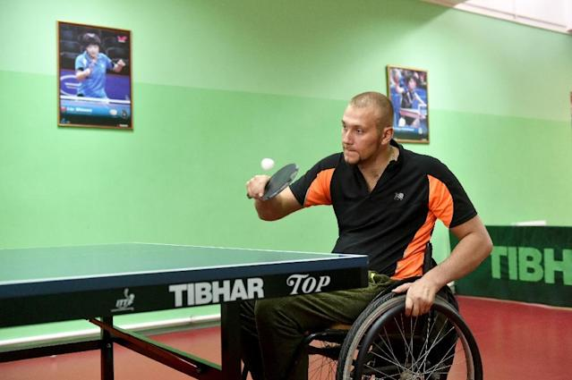 Disabled table tennis player Andrey Scherbatsky, 25, takes part in a training session in the Ukrainian city of Vinnytsya (AFP Photo/Sergei Supinsky)