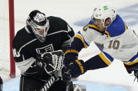 Los Angeles Kings goaltender Calvin Petersen, left, stops a shot next to St. Louis Blues center Brayden Schenn (10) during the second period of an NHL hockey game Friday, March 5, 2021, in Los Angeles. (AP Photo/Marcio Jose Sanchez)
