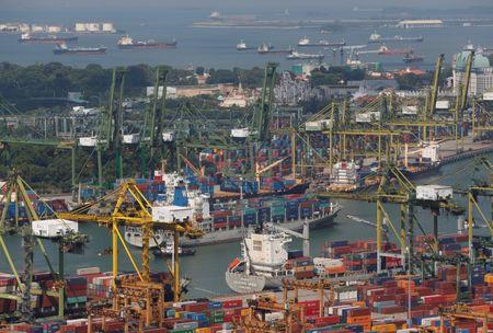 FILE PHOTO: A container ship arrives in a port in Singapore