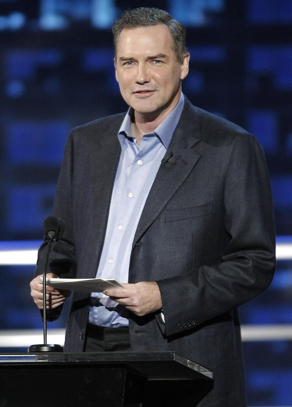 """FILE - Actor and comedian Norm Macdonald appears at the """"Comedy Central Roast of Bob Saget"""" in Burbank, Calif. on Aug. 3, 2008. Macdonald, a comedian and former cast member on """"Saturday Night Live,"""" died Tuesday, Sept. 14, 2021, after a nine-year battle with cancer that he kept private, according to Brillstein Entertainment Partners, his management firm in Los Angeles. He was 61. (AP Photo/Dan Steinberg, File)"""