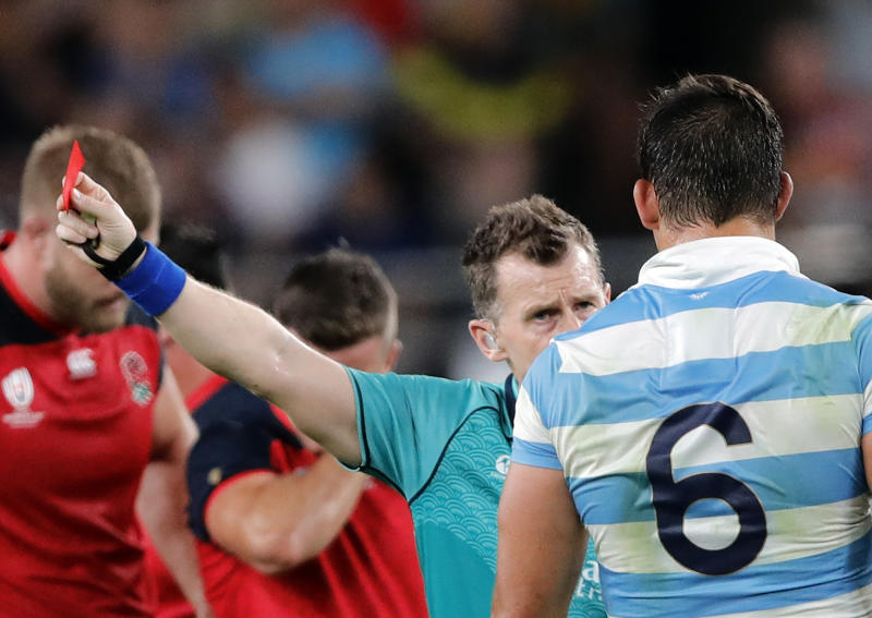 Referee Nigel Owens shows Argentina's Tomas Lavanini a red card after a dangerous tackle during the Rugby World Cup Pool C game at Tokyo Stadium between England and Argentina in Tokyo, Japan, Saturday, Oct. 5, 2019. (AP Photo/Christophe Ena)