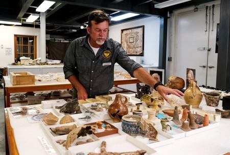 Archeologist Given inspects artifacts at Jamestown Rediscovery Center in Jamestown, Virginia