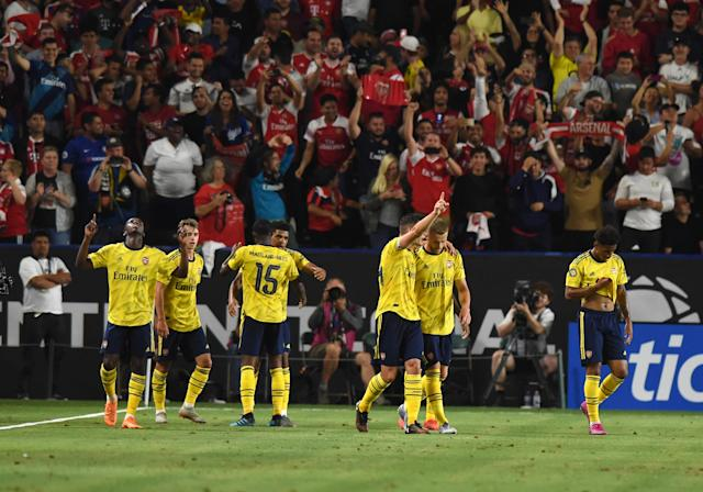 Arsenal players celebrate with fans after the game-winning goal against Bayern Munich on Wednesday. (Getty)