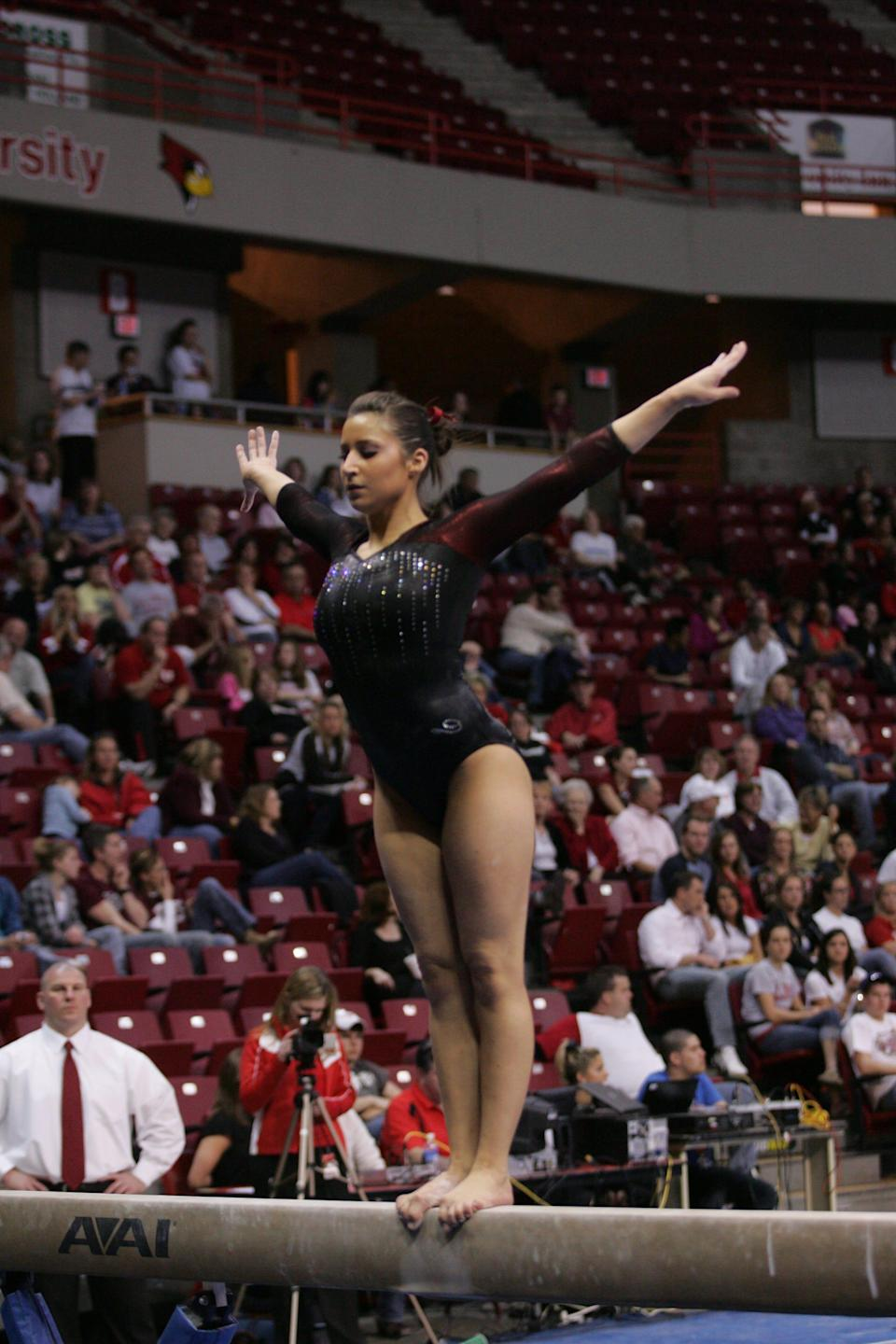 Former Division I gymnast Andrea Orris competes during her time at Illinois State University.