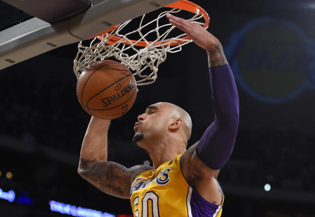 Los Angeles Lakers center Robert Sacre dunks during the first half of an NBA basketball game against the New York Knicks, Tuesday, March 25, 2014, in Los Angeles. (AP Photo/Mark J. Terrill)