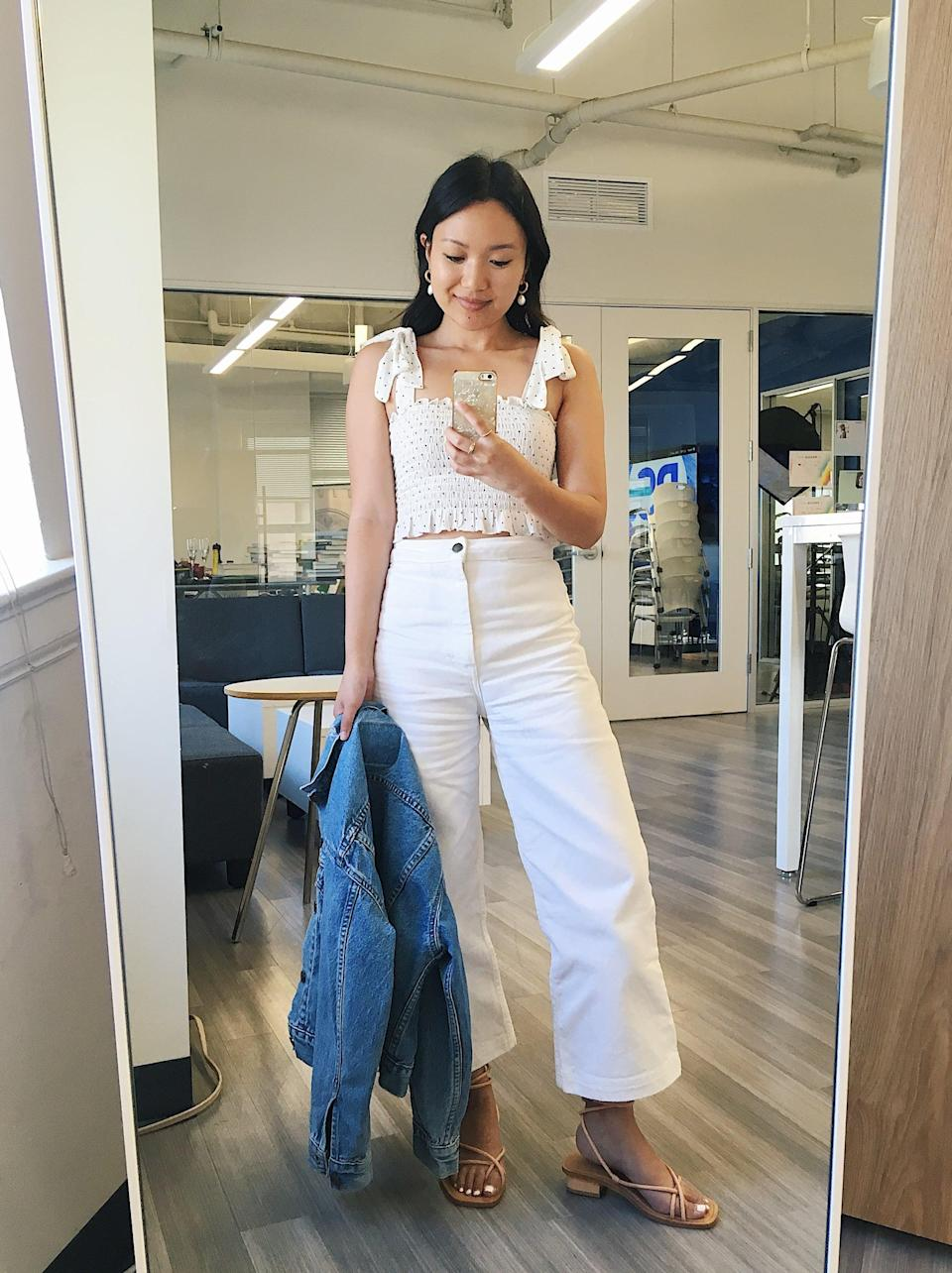 """<p>""""I love anything white and wide-leg, so <a href=""""https://www.popsugar.com/buy?url=https%3A%2F%2Fwww.shopbop.com%2Fmerida-pant-apiece-apart%2Fvp%2Fv%3D1%2F1531705531.htm%3Fref%3Dcovet.popsugar.com&p_name=these%20Apiece%20Apart%20pants&retailer=shopbop.com&evar1=fab%3Aus&evar9=46316761&evar98=https%3A%2F%2Fwww.popsugar.com%2Ffashion%2Fphoto-gallery%2F46316761%2Fimage%2F46316773%2FStephanie-Pick-Apiece-Apart-Merida-Pants&list1=shopping%2Cdenim%2Ceditors%20pick&prop13=api&pdata=1"""" rel=""""nofollow noopener"""" target=""""_blank"""" data-ylk=""""slk:these Apiece Apart pants"""" class=""""link rapid-noclick-resp"""">these Apiece Apart pants</a> were a no-brainer for me - I actually wear them year-round! Not only are they super flattering for my petite frame, but I actually find them to be so much easier to style than my skinny-leg counterparts - yes, even in a white color! This is a go-to Summer outfit formula for me: these pants, a romantic blouse, a denim jacket, and ankle-tie sandals or espadrilles. I also love wearing the pants with a linen blazer and tan leather accessories."""" - Stephanie Nguyen, editor, Native Content</p>"""