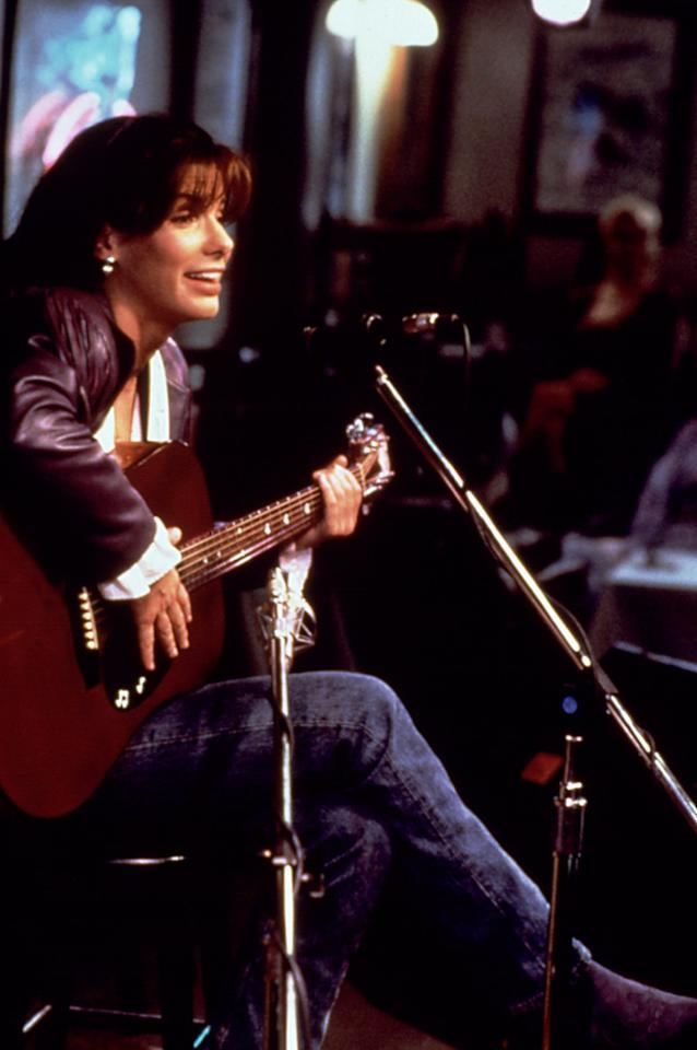 "Before Sandra Bullock's Oscar-winning role in ""The Blind Side,"" her breakthrough part in ""Speed,"" or even her charming turn in the rom-coms ""While You Were Sleeping"" or ""The Proposal,"" the A-list actress played Linda Lue Linden, one of four aspiring country singer-songwriters trying to make it in Nashville in the 1993 dramedy, ""The Thing Called Love."" The movie only earned a little more than $1 million domestically, but hey, at least it gave Bullock a chance to practice her vocal skills. The 47-year-old, whose mother was a German opera singer, sang and wrote her own song called ""Heaven Knocking On My Door"" for the film. If that's not reason enough for you to watch this movie, then consider that it marked the late River Phoenix's final performance.<br><br><a target=""_blank"" href=""http://www.amazon.com/gp/product/B000CCBCHG/ref=pd_lpo_k2_dp_sr_1?pf_rd_p=486539851&pf_rd_s=lpo-top-stripe-1&pf_rd_t=201&pf_rd_i=B0045LA5NW&pf_rd_m=ATVPDKIKX0DER&pf_rd_r=1E33FA9YY9VXZD8DBX0Q"">Buy ""The Thing Called Love"" on DVD</a>"