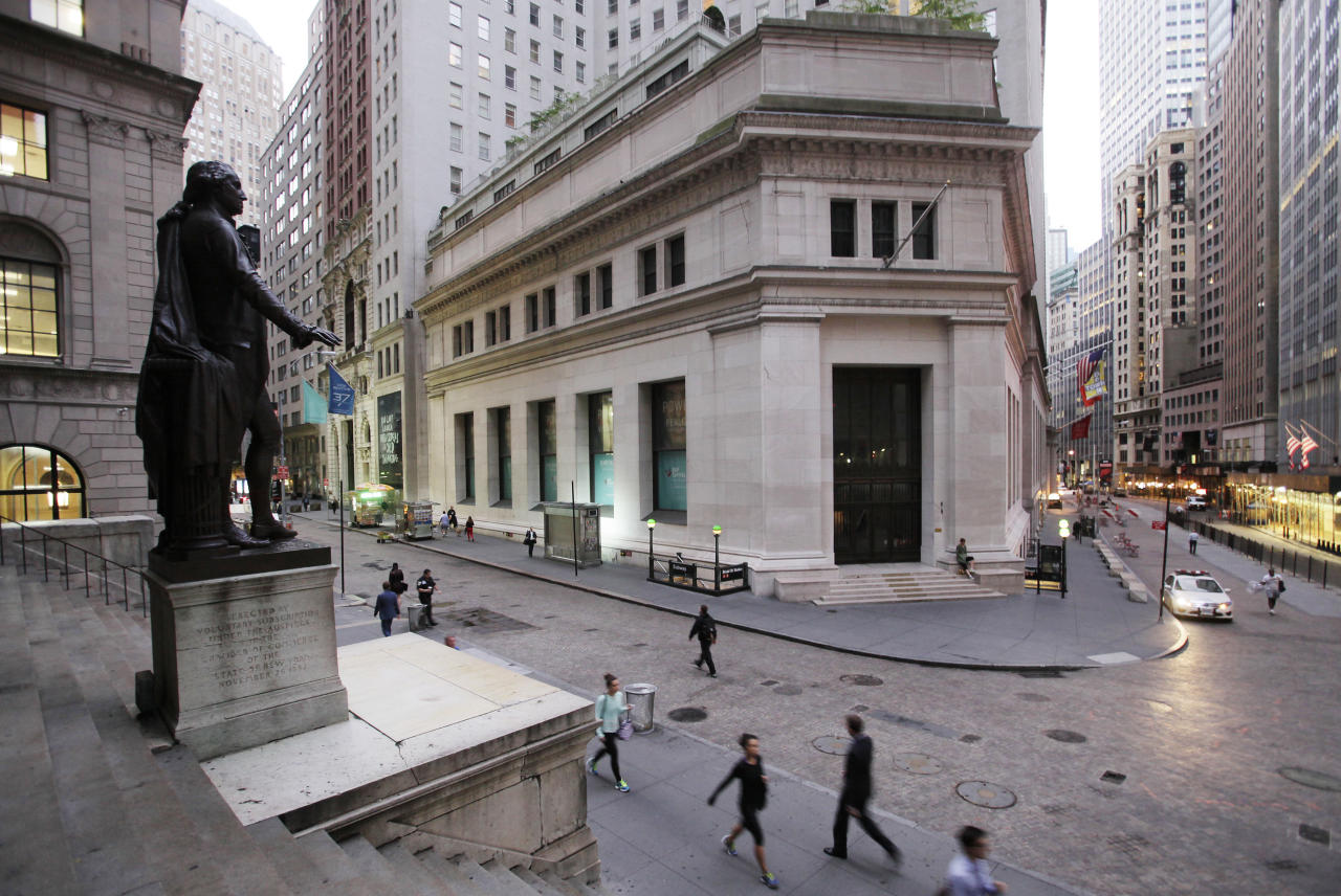 <p> FILE - In this Oct. 8, 2014, file photo, people walk to work on Wall Street beneath a statue of George Washington, in New York. U.S. stocks are opening higher Tuesday, Nov. 21, 2017, as most industries, including technology and health care companies, start the day with solid gains. (AP Photo/Mark Lennihan, File) </p>