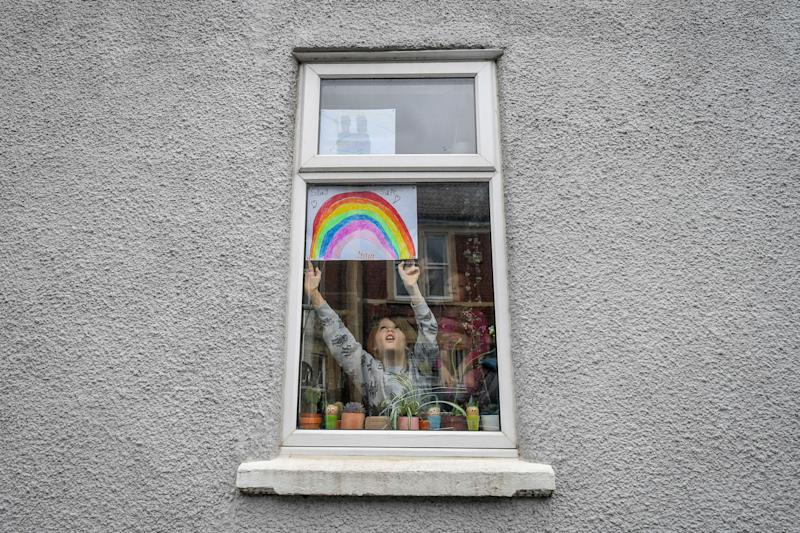 The Queen referenced the drawings of rainbows being placed in household windows to keep children's spirits up during the lockdown. (Photo: ASSOCIATED PRESS)