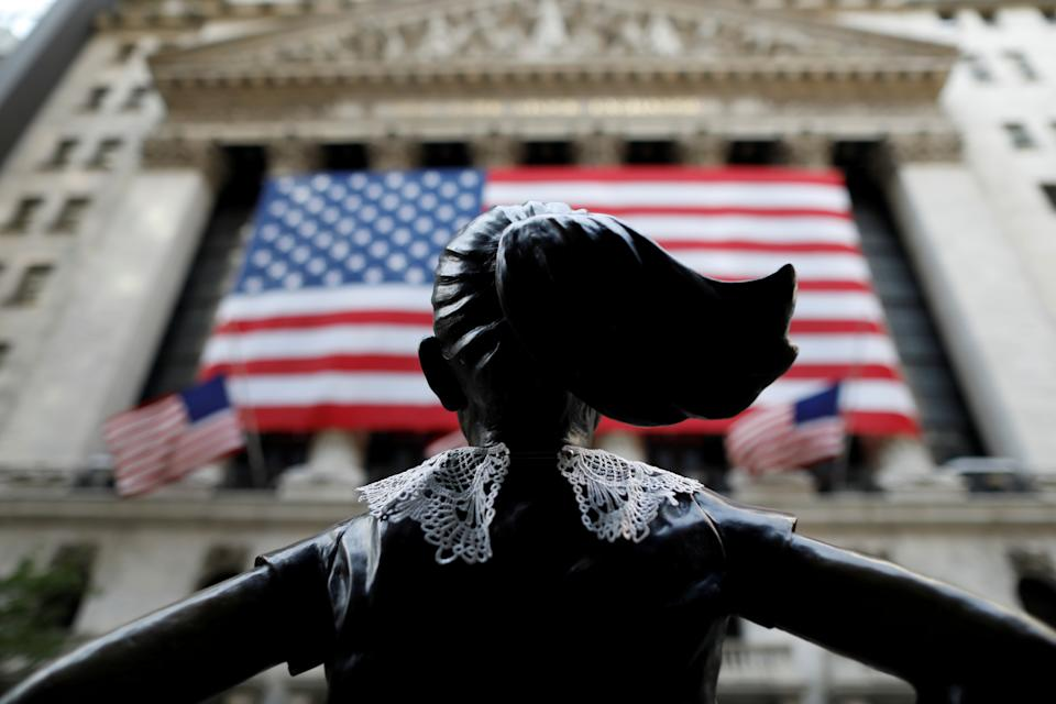 A jabot collar is seen placed on the Fearless Girl statue outside of the New York Stock Exchange (NYSE) in honor of recently passed Associate Justice of the Supreme Court of the United States Ruth Bader Ginsburg in Manhattan, New York City, U.S., September 21, 2020. REUTERS/Andrew Kelly     TPX IMAGES OF THE DAY