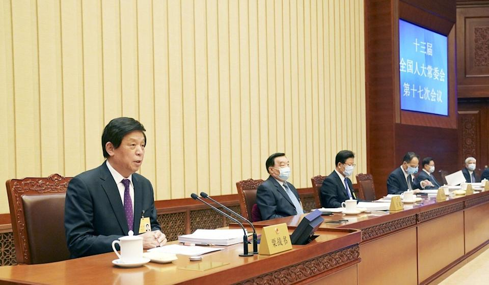 A National People's Congress Standing Committee meeting last year, presided over by chairman Li Zhanshu (left). Photo: Xinhua