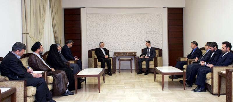In this photo released by the Syrian official news agency SANA, Syrian President Bahsar Assad, center right, speaks during a meeting with Alaeddin Boroujerdi, center left, head of Iran's parliamentary committee on national interest and foreign policy, in Damascus, Syria, Monday, April 22, 2013. Assad said during the meeting that the Middle East is being subjected to plans that targets its stability and unity of its territories. (AP Photo/SANA)
