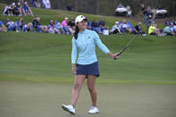 Danielle Kang reacts after missing a putt on the 18th green in a playoff hole during the final round of the Tournament of Champions LPGA golf tournament, Sunday, Jan. 24, 2021, in Lake Buena Vista, Fla. (AP Photo/Phelan M. Ebenhack)
