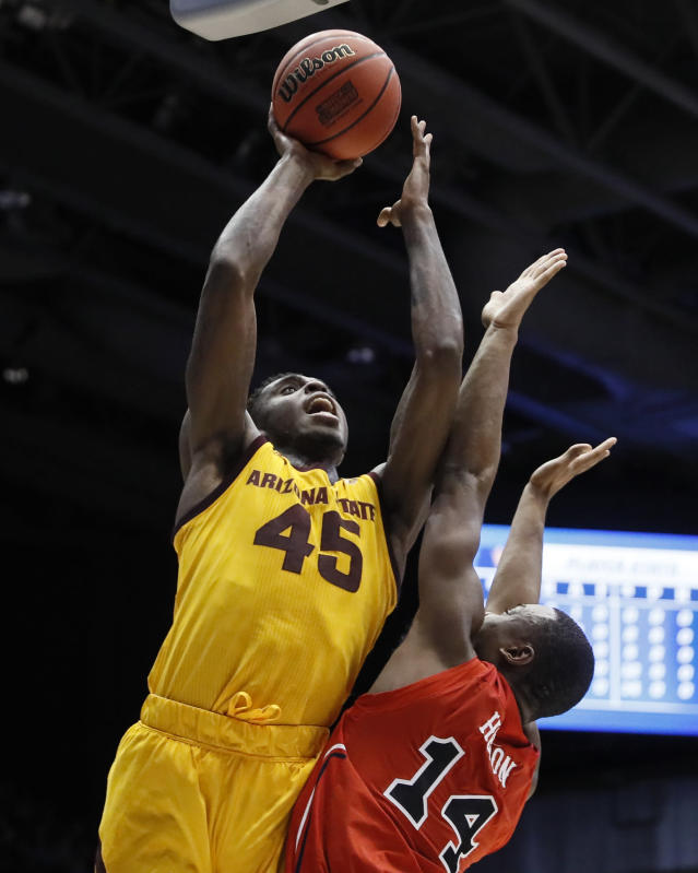 Arizona State's Zylan Cheatham (45) shoots over St. John's Mustapha Heron (14) during the first half of a First Four game of the NCAA men's college basketball tournament Wednesday, March 20, 2019, in Dayton, Ohio. (AP Photo/John Minchillo)