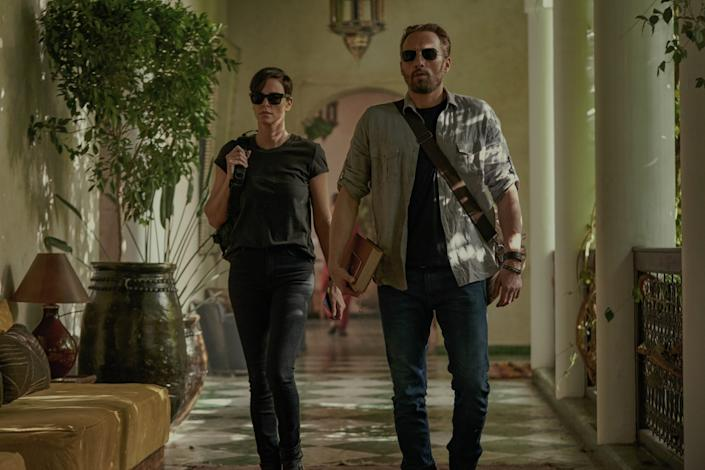 """THE OLD GUARD (L to R) CHARLIZE THERON as ANDY and MATTHIAS SCHOENAERTS as BOOKER in """"The Old Guard."""" <span class=""""copyright"""">(Aimee Spinks/NETFLIX)</span>"""