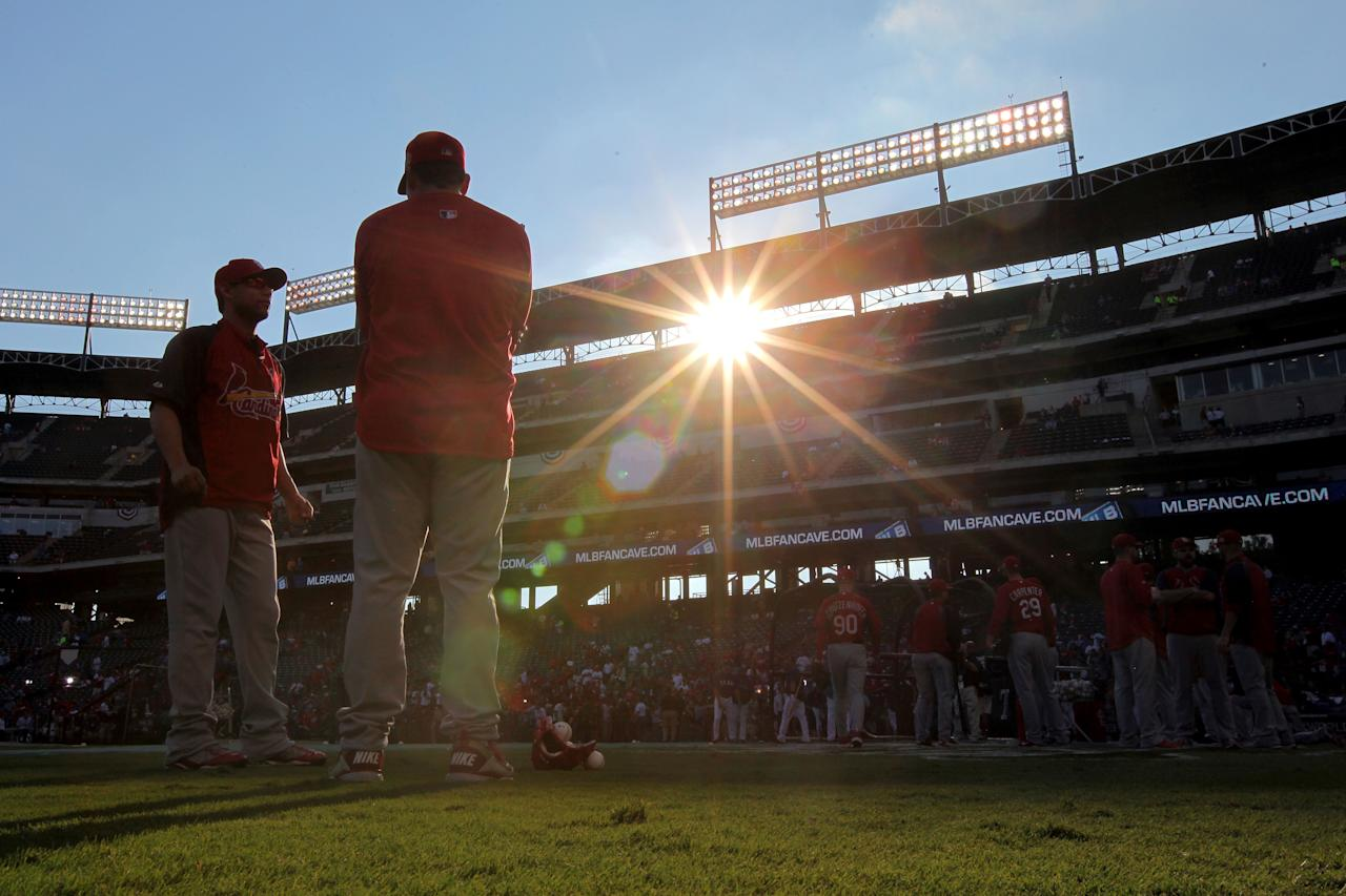 ARLINGTON, TX - OCTOBER 23:  The St. Louis Cardinals warm up before Game Four of the MLB World Series against the Texas Rangers at Rangers Ballpark in Arlington on October 23, 2011 in Arlington, Texas.  (Photo by Doug Pensinger/Getty Images)