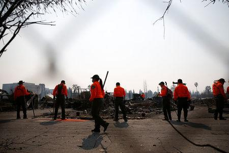 Urban Search and Rescue teams search for two missing people amongst ruins at Journey's End Mobile Home Park destroyed by the Tubbs Fire in Santa Rosa, California, U.S. October 13, 2017. REUTERS/Stephen Lam