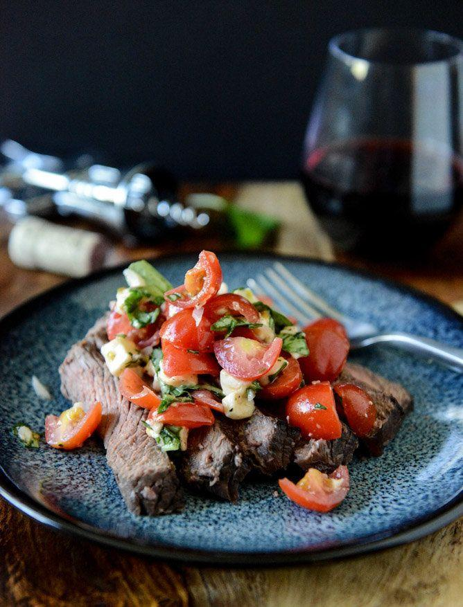 "<strong>Get the <a href=""http://www.howsweeteats.com/2013/04/red-wine-marinated-flank-steak-with-cherry-tomato-caprese-salsa/"" target=""_blank"">Red Wine Marinated Flank Steak with Cherry Tomato Caprese Salsa recipe</a> from How Sweet It Is</strong>"
