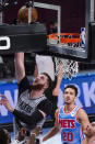 Portland Trail Blazers center Jusuf Nurkic, top left, dunks past Brooklyn Nets guard Landry Shamet (20) during the second half of an NBA basketball game, Friday, April 30, 2021, in New York. (AP Photo/Mary Altaffer)