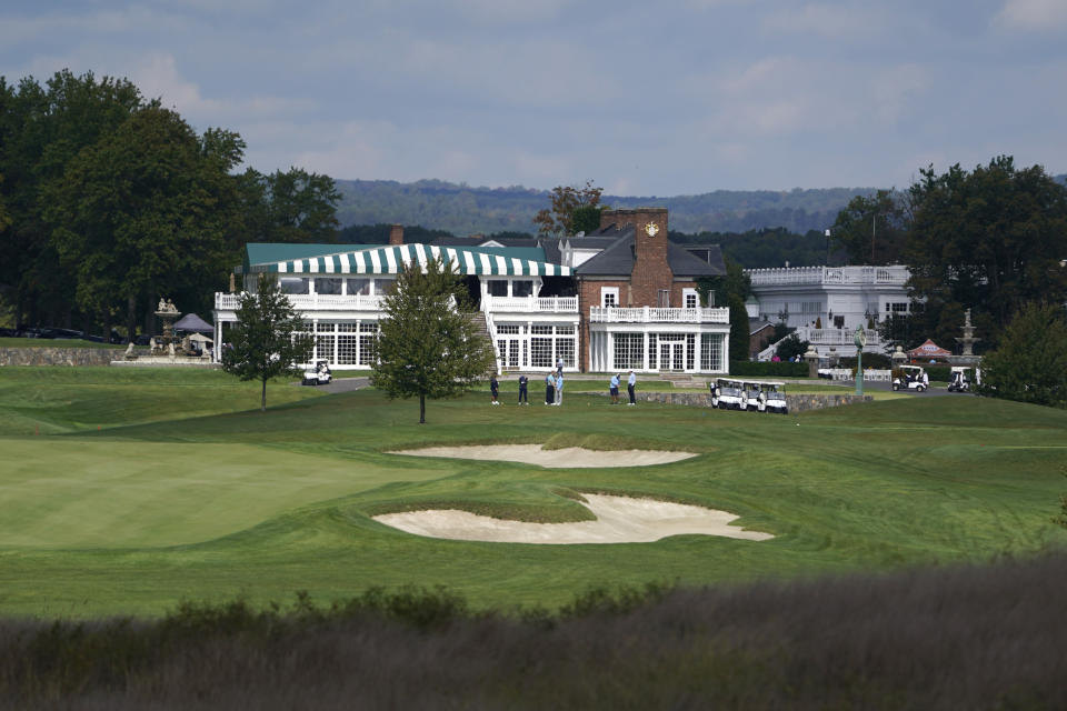 FILE - In this Friday, Oct. 2, 2020, file photo, golfers play golf at Trump National Golf Club in Bedminster, N.J. The PGA of America voted Sunday, Jan. 10, 2021, to not play the 2022 PGA Championship at the club because of the Trump-fueled insurrection at the Capitol on Wednesday, Jan. 6. (AP Photo/Seth Wenig, File)