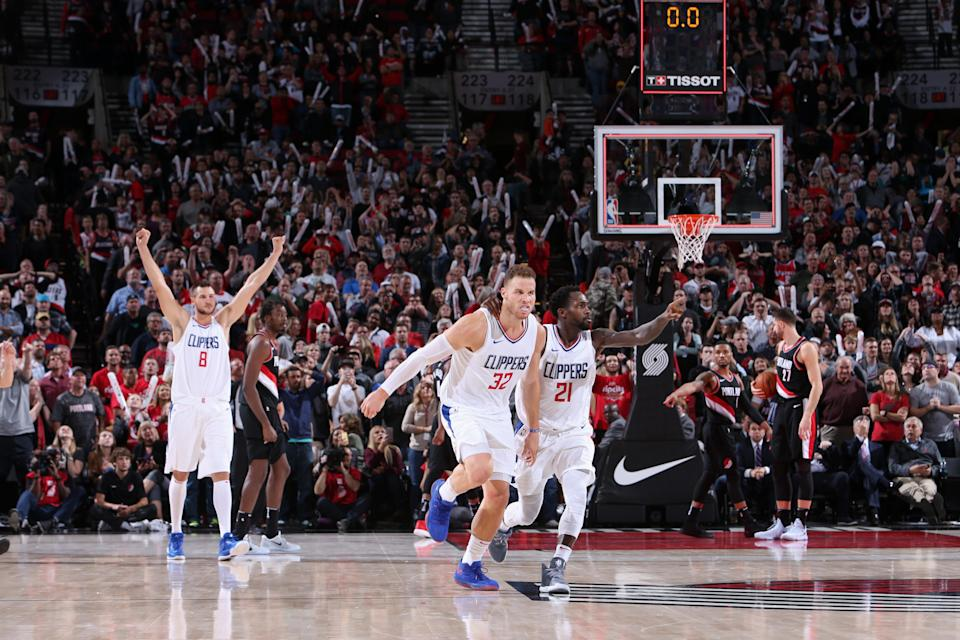 Blake Griffin and Patrick Beverley celebrate Griffin's game-winning shot to beat the Trail Blazers in Portland. (Getty)