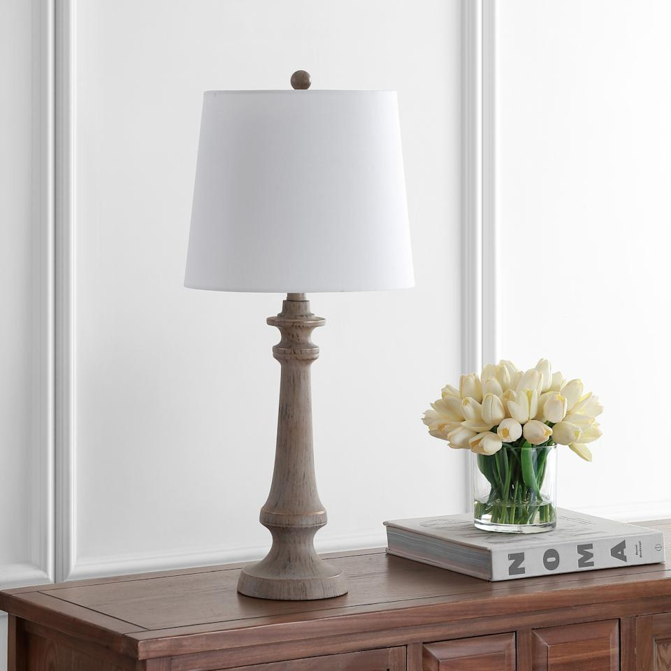 """This lamp is designed to have a candlestick silhouette and antique brown finish. It's so simple that it can fit in just about anywhere. <a href=""""https://fave.co/2Hl9Dsk"""" target=""""_blank"""" rel=""""noopener noreferrer"""">Find it for $54 at Walmart</a>."""