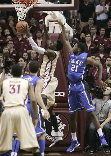 Florida State's Okaro White has his shot blocked from behind by Duke's Amile Jefferson in the first half of an NCAA college basketball game Saturday, Feb. 2, 2013, in Tallahassee, Fla. (AP Photo/Steve Cannon)