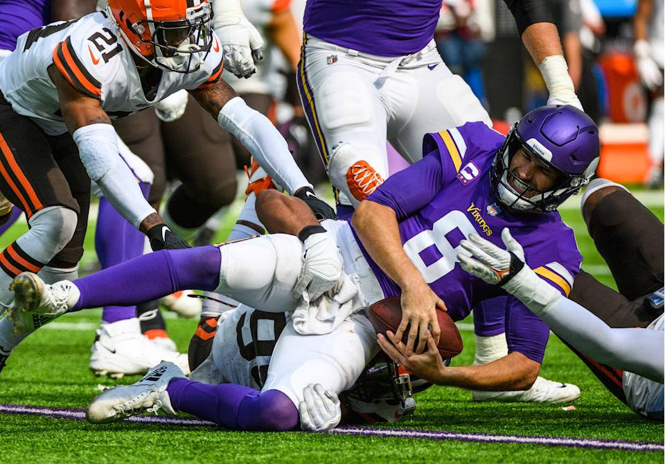 MINNEAPOLIS, MN - OCTOBER 03: Kirk Cousins #8 of the Minnesota Vikings is sacked with the ball by Myles Garrett #95 of the Cleveland Browns in the third quarter of the game at U.S. Bank Stadium on October 3, 2021 in Minneapolis, Minnesota. (Photo by Stephen Maturen/Getty Images)
