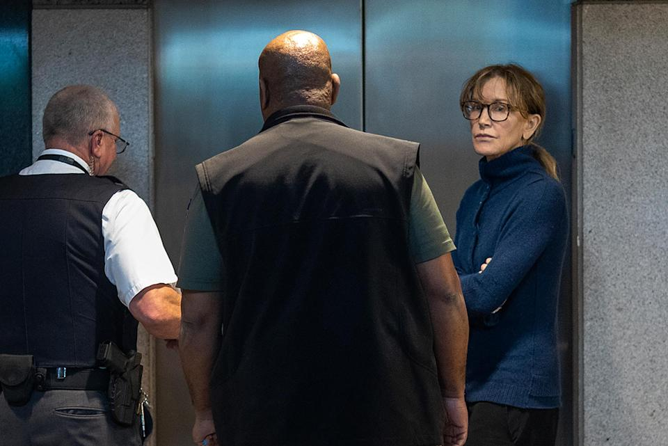 Felicity Huffman in FBI custody on Tuesday. She is charged with felony conspiracy to commit mail fraud and honest services mail fraud, according to a complaint. She posted $250,000 bond and was released. (Photo: Getty Images)