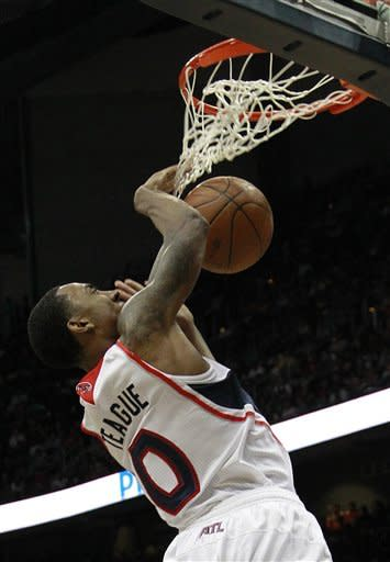 Atlanta Hawks guard Jeff Teague scores in the second half of Game 2 of an NBA first-round playoff basketball series against Boston Celtics on Tuesday, May 1, 2012, in Atlanta. Boston won 87-80 and evened the series at one game each. (AP Photo/John Bazemore)