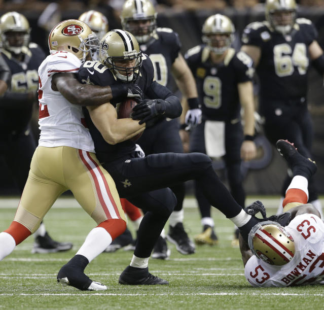 New Orleans Saints tight end Jimmy Graham (80) is tackled by San Francisco 49ers inside linebacker Patrick Willis, left, and inside linebacker NaVorro Bowman (53) in the first half of an NFL football game in New Orleans, Sunday, Nov. 17, 2013. (AP Photo/Dave Martin)
