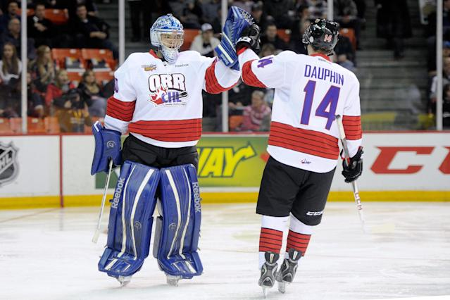 HALIFAX, CANADA - JANUARY 16: Laurent Dauphin #14 of Team Orr celebrates his second period goal with teammate Spencer Martin #30 during the CHL Top Prospects game Team Cherry at the Halifax Metro Centre on January 16, 2013 in Halifax, Nova Scotia, Canada. Team Orr defeated Team Cherry 3-0. (Photo by Richard Wolowicz/Getty Images)