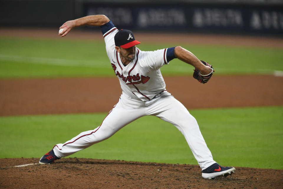 FILE - Atlanta Braves pitcher Darren O'Day works against the Miami Marlins during a baseball game in Atlanta, in this Monday, Sept. 21, 2020, file photo. The Yankees quickly found a replacement for their bullpen, agreeing to a $2.5 million, one-year contract with submarining right-hander Darren O'Day, a person familiar with the negotiations told The Associated Press on Wednesday, Jan. 27, 2021. (AP Photo/John Amis, File)